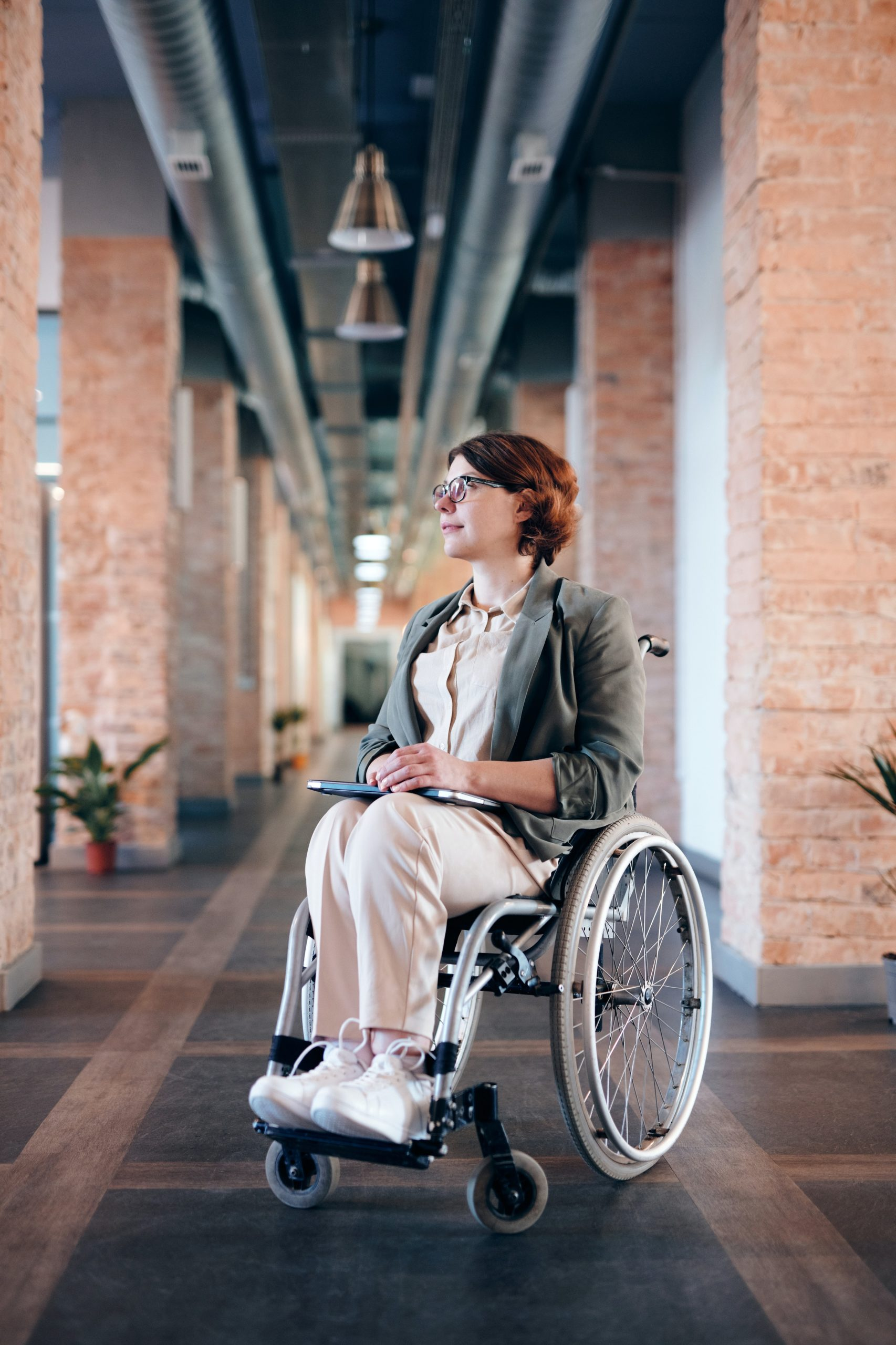 person-first and identity-first language in a wheelchair